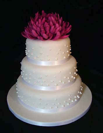 wedding cakes with flowers on top. This cake is available with or